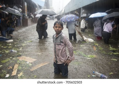 Mumbai / India 29 August 2017 A young wet boy stands with flood waters  up to his knees at Dadar railway station Mumbai Maharashtra  India