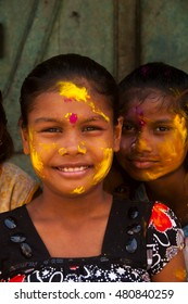 MUMBAI, INDIA -29 SEPTEMBER 2012 : Portrait unidentified children face smeared with colors participate in procession of Ganesh Immersion which marks the end of ten day long Ganesh Chaturthi festival.