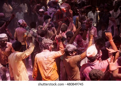 MUMBAI, INDIA -29 SEPTEMBER 2012 : People throw colors to each other and dancing during the procession of Ganesh Immersion which marks the end of the ten-day long Ganesh Chaturthi festival.