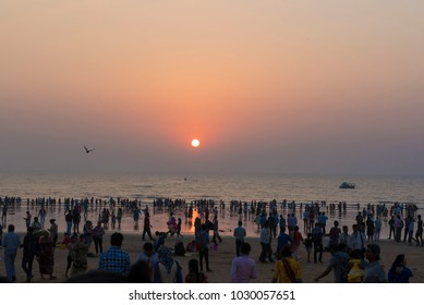 Mumbai / India 3 February 2018 Gropu of people on the Juhu beach at sunset in Bombay Mumbai Maharashtra  India