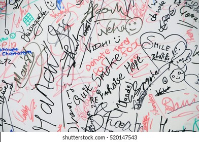 MUMBAI, INDIA, 8 FEBRUARY 2015 : unidentified people writing message and signature on canvas and make art during the Kala Ghoda Arts Festival Mumbai,