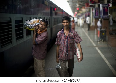 MUMBAI, INDIA - AUG 10: Staffs from station restaurant are serving breakfast to the commuter on train on August 10 2012, Mumbai, India.