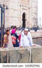 MUMBAI , INDIA - AUG 24 : Indian people at the Gateway of India in Mumbai India on August 24 2019. The Gateway of India is an arch monument built during the 20th century