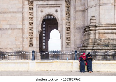 MUMBAI , INDIA - AUG 24 : Indian women at the Gateway of India in Mumbai India on August 24 2019. The Gateway of India is an arch monument built during the 20th century