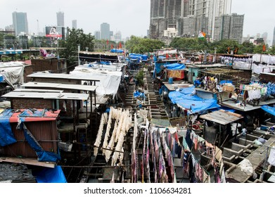 MUMBAI, INDIA - AUGUST 04, 2016: busy dhobi ghat and many people working inside of it to do laundry