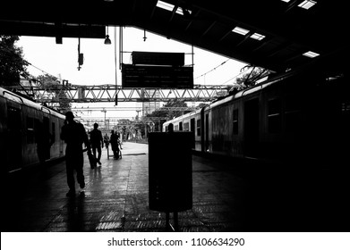 MUMBAI, INDIA - AUGUST 04, 2016: A silhouette picture of the busy train station in mumbai as black and white picture