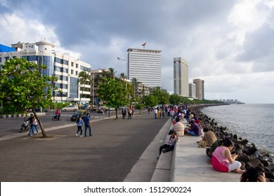 Mumbai, India, August 2019: A large amount of people roaming the street of Mumbai near Marine drive after a heavy rainfall stops . Marine drive is a famous Tourist attraction in Mumbai.