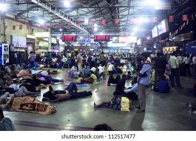 MUMBAI, INDIA - AUGUST 21: Commuters at Chhatrapati Shivaji Terminus on August 21, 2011 in Mumbai, India.  Every day about 3 to 4 millions passengers pass through the station.
