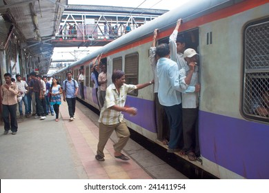 MUMBAI, INDIA - AUGUST 21: Commuting by train on August 21, 2011 in Mumbai, India. Mumbai Suburban Railway carries more than 7 million commuters on a daily basis.