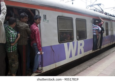 MUMBAI, INDIA - AUGUST 21: Unidentified locals and tourists commute by train on August 21, 2011 in Mumbai, India. Mumbai Suburban Railway carries more than 7 million commuters on a daily basis.