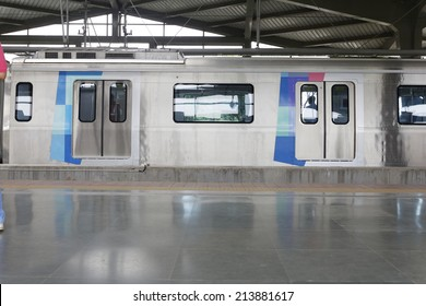 MUMBAI, INDIA - August 29th 2014:Latest Mumbai Metro train in station, commuters sitting & standing in the metro. Comfortable, modern , fast, new & air conditioned way of transport.