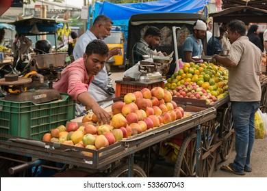 Mumbai, India -December 11, 2016 - Indian trader in his shop on local market selling all kind of goods