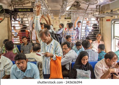 MUMBAI, INDIA - DECEMBER 12, 2012: Unidentified passengers inside Indian Railway local train on December 12, 2012 in Mumbai, India. Indian Railways carries about 7,500 million passengers annually.
