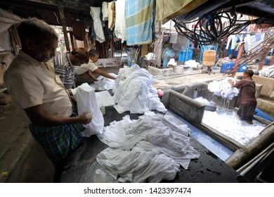 MUMBAI, INDIA - DECEMBER 16, 2018: Unidentified workers clean clothes in the public Dhobi Ghat in Mumbai