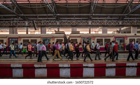 Mumbai, India - December 18, 2019 : Unidentified passengers walking on a platform at rush hours of CST station, one of the bussiest train station for working class people in Mumbai