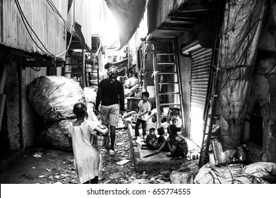 MUMBAI, INDIA - DECEMBER 26, 2016: Kids walking on the street in dharavi slum with  black and white color effect