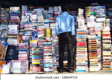 MUMBAI, INDIA - FEBRUARY 13: Piles of books on the booksellers-street on Febuary 13, 2012 in Mumbai. Here can buy books, originals and counterfeits, at 20-60% of the listed publisher's price;
