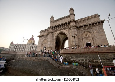 MUMBAI, INDIA - FEBRUARY 19:  Crowds of people explore the Gateway of India on February 19, 2011 in Mumbai.  The Gateway is a popular tourist destination for Indians as well as foreigners.