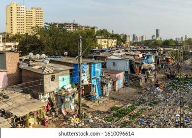 Mumbai, India - February 26, 2019: View of garbage slums poor area near Suburban Railway. Dharavi Slum at Mumbai