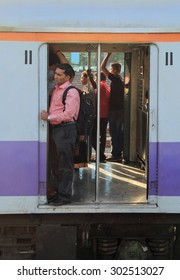 MUMBAI, INDIA - FEBRUARY 28, 2015: people are standing in the moving carriage of local train, Mumbai