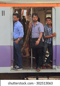 MUMBAI, INDIA - FEBRUARY 28, 2015: people are standing in the moving carriage of local train, Mumbai, India