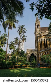 Mumbai, India - January 17, 2018: Garden and clock tower of the historic gothic Bombay High Court building in Mumbai