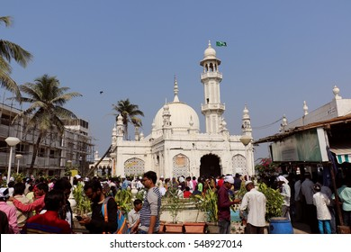 Mumbai, India - January 2, 2017: Unidentified pilgrims at Haji Ali Dargah, a historical landmark and one of the most prestigious Islamic symbols situated in South Mumbai.