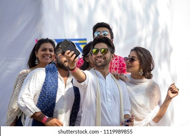 MUMBAI, INDIA - JANUARY 29, 2017 : Unknown Indian youth makes a selfies on a smartphone in the street of the city of Mumbai, India