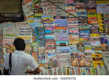 MUMBAI, INDIA - JANUARY 5, 2014: Man in front of newspaper booth in India