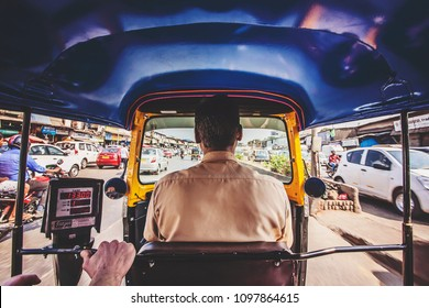 Mumbai, India, January 7, 2018: Inside rickshaw car in the main road traffic