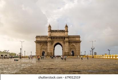 MUMBAI, INDIA - July 09, 2017 - Unidentified people walking  around the Gateway of India
