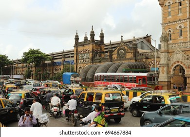 Mumbai, India - July 10th, 2017 - Big traffic jam in south Mumbai, A lot of taxis,private cars,public bus, motorcycles and many local people walking along the street in the busy road. India, Asia.