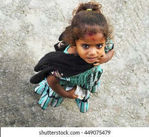 MUMBAI, INDIA - JULY 18: Young indian girl Anita, 4, poses for a photo on July 18, 2015 in deprived areas of Mumbai, Maharashtra, India. There are about 60% of people of the city live in slums.