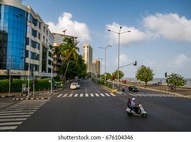 MUMBAI, INDIA - JULY 8, 2017 : Marine Drive is one of the famous 3.6-kilometre-long boulevard in South Mumbai in the city of Mumbai