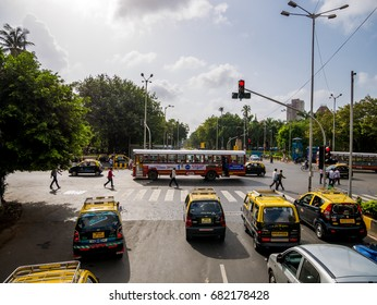 MUMBAI, INDIA - JULY 8, 2017 : Famous black and yellow taxis running on streets of Mumbai