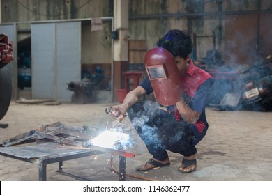 Mumbai, India - July 8, 2018 - Indian boys learning about welding in vocational school