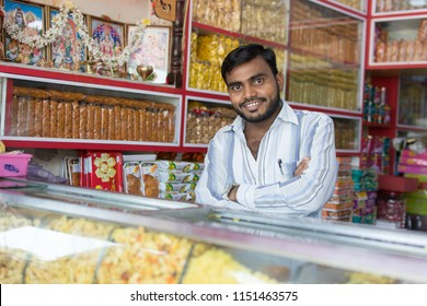 Mumbai, India - July 8, 2018 - Vendors on market selling sweets and food - India