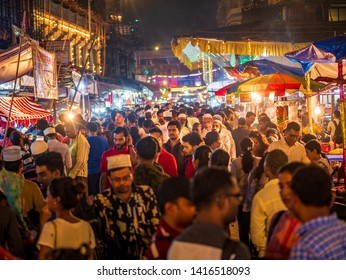 Mumbai, India - June 01, 2019 : Busy Streets of Bhendi bazar with food stalls selling halal food and sweets in holy month of Ramadan Ramazan
