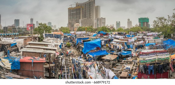 MUMBAI, INDIA - JUNE 24, 2017: Panorama of Dhobi Ghat the worlds biggest open air laundry place in the slums of Mumbai where garments are washed and line dried.