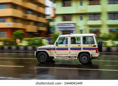 Mumbai, India - June 30, 2019 : Mumbai police patrol van running on a streets of Marine drive