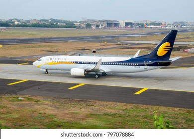 Mumbai, India - June 8, 2014: Jet Airways Boeing B737-800 ready for takeoff from Mumbai Airport.