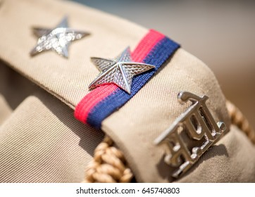 MUMBAI, INDIA - June 9, 2016: Closeup of shoulder badges on the uniform of Maharashtra police officer, Mumbai, Maharashtra, India, Southeast, Asia.