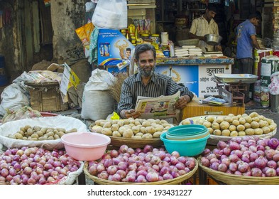 Mumbai, India - March 15 - Man selling fresh produces, red onion, potato at local market