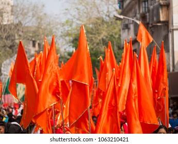 Mumbai, India - March 18, 2018: Hindu safron flag flying high on Hindu New Year Parade (Gudhi Padva) is an annual parade on the famous Girgaon, South Mumbai