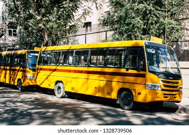 Mumbai India March 3, 2019 View of traditional yellow school bus parked in the streets of Mumbai in the afternoon