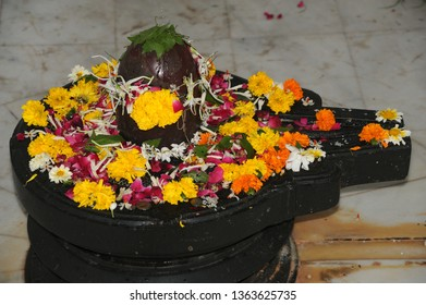 Mumbai; India; March-2013: Shiva Linga decorated with flowers & bel patra or bael patra for Maha Shivaratri; a Hindu festival celebrated annually in honour of the god Shiva. Season's Greeting
