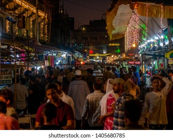 Mumbai, India - May 11, 2019 : Busy Streets of Bhendi bazar with food stalls selling halal food and sweets in holy month of Ramadan Ramazan