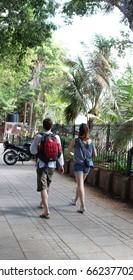 Mumbai, India -  May 27, 2017: A tourist duo strolling next to Azad Maidan in South Mumbai