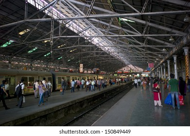 MUMBAI, INDIA - NOV 21: Commuters at Chhatrapati Shivaji Terminus on November 21, 2012 in Mumbai, India. Every day about 3 to 4 millions passengers pass through the station.