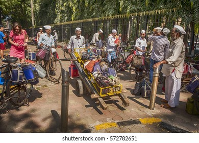 MUMBAI, INDIA - NOVEMBER 10, 2016: In Mumbai, a dabawalah with a fully loaded hand cart sets off to deliver lunches from the train station to people in offices and shops throughout the city.